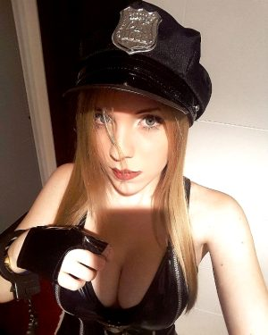 perfect little blonde dressed like a cop handcuffed with big boobs ready for facefuck